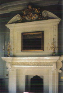 The Inigo Jones Chimney Piece in the Royal Closet of the Queen's Chapel, surmounted by the combined arms of Charles II and Catherine of Braganza and decorated with Portuguese palms.