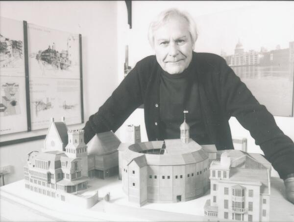 Sam Wanamaker with a plan of his vision for the Shakespeare's Globe project with what is now the SWP shown as an integral part under his arm to the left.