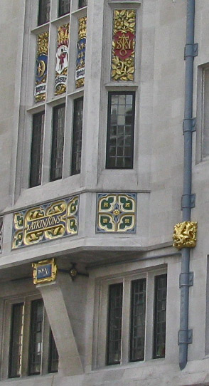Gilded and polychromed stonework and elaborate metalwork on the Burlington Gardens facade.