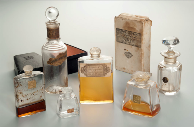 "A collection of perfume bottles found in Czarina Alexandra's bed chamber at Tsarskoye Selo Palace including, to the left, a bottle of Atkinson's White Rose, her favourite perfume, which she described as ""clean and infinitely sweet."""