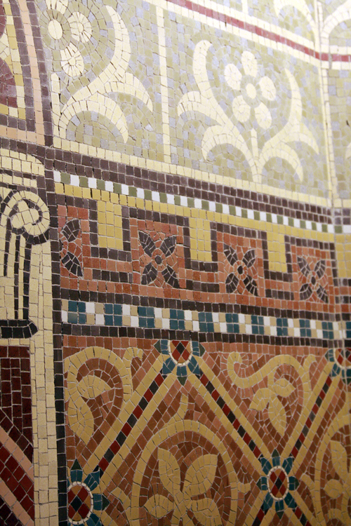 Mosaic borders on the lower walls.