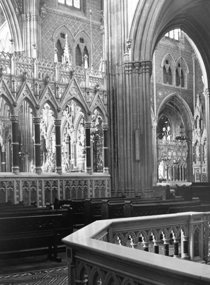 The Crossing Screens from the South transept.  The elaborate marble screens enclosing the Lady Chapel can be glimpsed through the arch on the right.